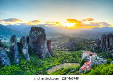 Sunset over monasteries of Roussanou and Saint Nicholas Anapavsa at Meteora, Greece