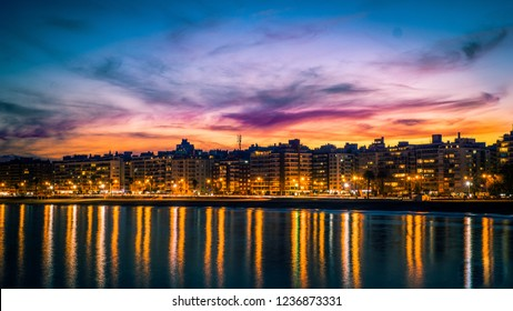 Sunset over Montevideo, contrast of colours and reflection of the light in the water
