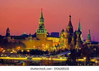 Sunset over the Moscow Kremlin, Russia. Moscow city skyline, cityscape. Bridge in the park Zaryadye. Moscow Kremlin, Cathedral of Vasily the Blessed, Spasskaya Tower