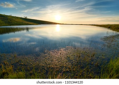 Sunset over mountain lake. Osogovski mountains , Kalin kamen peak. Ecology concept.