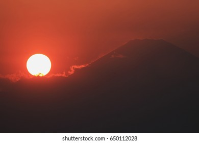 A sunset over the mountain silhouette and sunset
