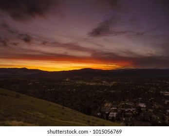 Sunset over mountains and the city of Missoula, MT