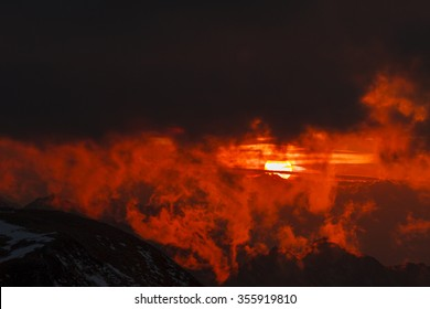 Sunset over mountains and clouds