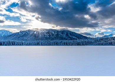 Sunset over the mountains and fresh snow on Lake Lillian near Invermere, BC