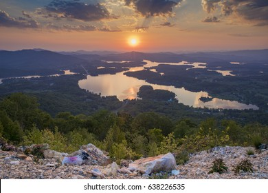 Sunset over mountains and lake