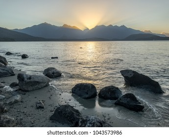 Sunset over the mountains in Manapouri, New Zealand