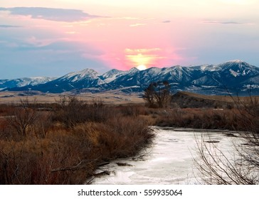 Sunset over the Mountains near Yellowstone National Park north entrance. The Gardner river in the foreground