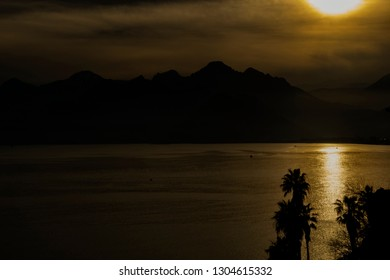 Sunset over Mountains and the Sea
