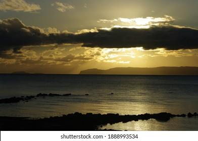 Sunset over the Mull of Kintyre , Sanda  and Sheep island, Argyll, Scotland.UK