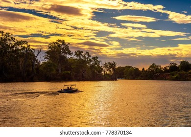 Sunset over Murray river  with people riding a boat in Mildura, Australia