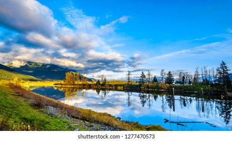 Sunset over Nicomen Slough along the Lougheed Highway between the towns of Deroche and Mission, British Columbia, Canada