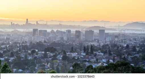 Sunset over Oakland and San Francisco Hazy Skylines. Oakland Hills, Alameda County, California, USA.