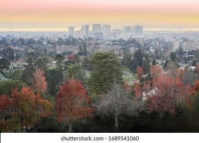 Sunset over Oakland via Mountain View Cemetery. Oakland, Alameda County, California, USA.