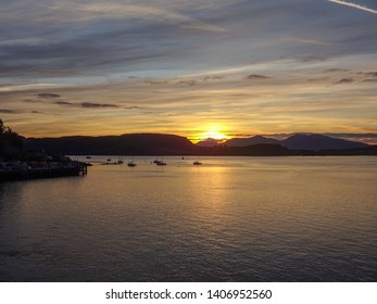 Sunset over Oban Bay looking to the Isle  of Mull in Scotland Great Britain