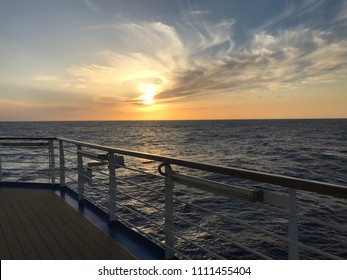 Sunset over ocean from cruiseline handrail