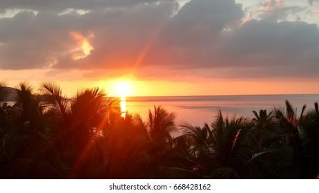 Sunset over ocean in Fiji.