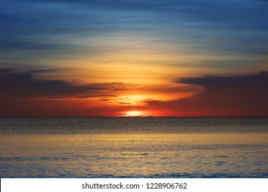sunset over the ocean on a clear evening