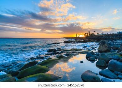 Sunset over ocean in Playa Blanca on Lanzarote island, Spain