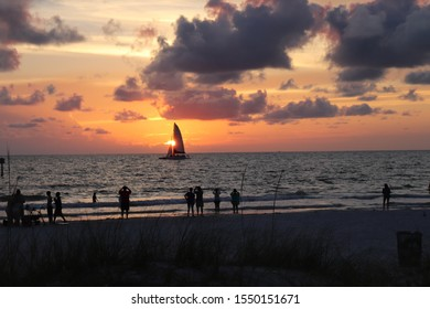 Sunset over the ocean with sailboat