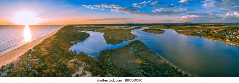Sunset over ocean and Snowy River - wide aerial panoramic landscape