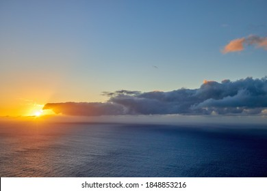 Sunset over the ocean. View from the westernmost point of the island of Madeira, Ponta do Pargo lighthouse. Quiet moment. Traveling around the island of Madeira in Portugal.