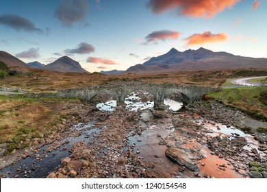 Sunset over the old bridge at Sligachan on the Isle of Skye in Scotland with the Cuillin mountains in the background