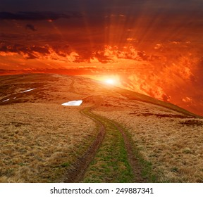 sunset over path in mountains