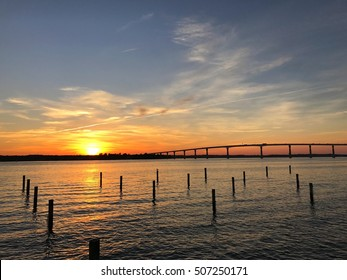 Sunset over the Patuxent River in Southern Maryland with the Thomas Johnson bridge silhouette in the background.