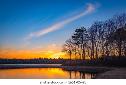 Sunset over peaceful cranberry bog in winter on Cape Cod