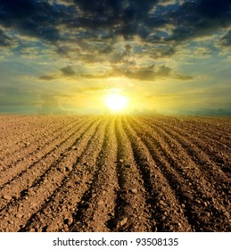 sunset over ploughed field