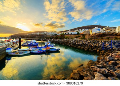 Sunset over a port in Gran Tarajal, Fuerteventura, Canary islands