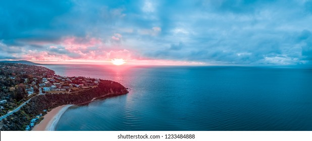 Sunset over Port Phillip Bay in Australia - wide aerial panorama