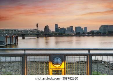 Sunset Over Portland Oregon downtown waterfront by Hawthorne Bridge along Willamette River