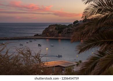 Sunset over the Porto de Abrigo de Albufeira, Albufeira Bay in Albufeira, Portugal.