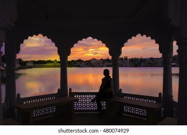 Sunset over Pushkar lake, seen through Indian window frame. Pushkar, India