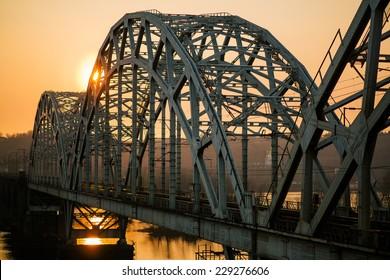 sunset over railway bridge across Dnepr river. Kiev, Ukraine