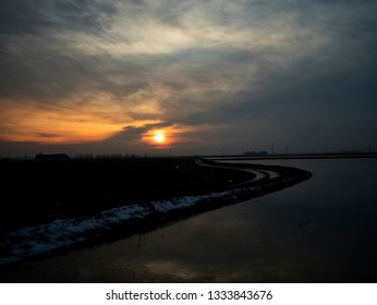 Sunset over the river, cloudy sky, horizontal image