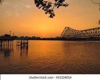 Sunset over river ganges with Howrah bridge in the background