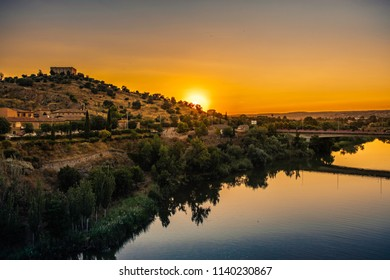 Sunset over the river Tajo as it passes through Toledo, Spain