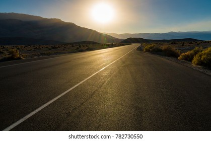 Sunset over a road in Death Valley.