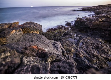 Sunset over rocky beach at Lanzarote, Canary Islands, Spain