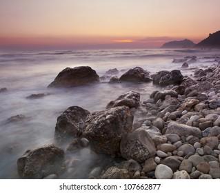 Sunset over Rocky coastline at the island of Corfu