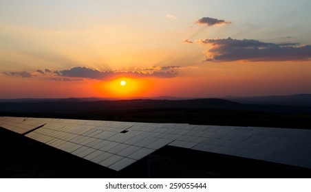 Sunset over rows of photovoltaic modules