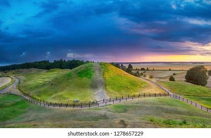 Sunset over Royal Mounds in Gamla Uppsala, Uppland, Sweden (HDR image)
