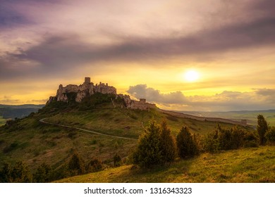 Sunset over the ruins of Spis Castle in Slovakia.  Spis Castle is a national monument and one of the biggest European castles by area.