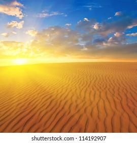 sunset over a sand desert