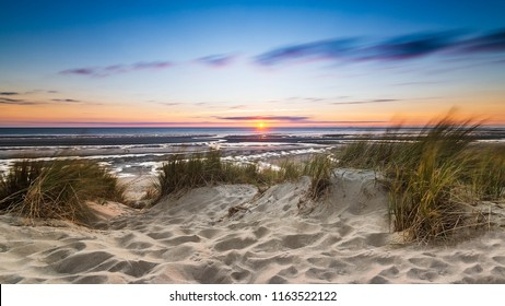 Sunset over sand dune and beach