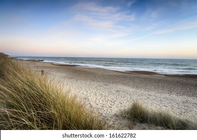 Sunset over sand dunes at Hengistbury Head beach near Christchurch in dorset