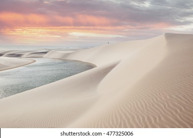 Sunset over the sand dunes and lagoons in the Lencois Maranhenses national park in Maranhao state, Brazil.