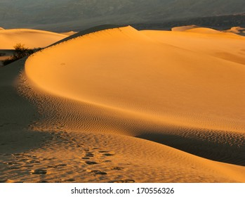 Sunset over the Sand Dunes of Mesquite Flats desert, Death Valley, California